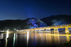 Long exposure of night illuminations on the Togetsu Bridge and mountains during Arashiyama Hanatouro festival in Kyoto Royalty Free Stock Photos