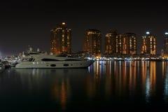 Night photography of luxurious yachts moored in Porto Arabia Doha Qatar. Long exposure night photography of luxurious yachts moored in Porto Arabia Doha Qatar stock image