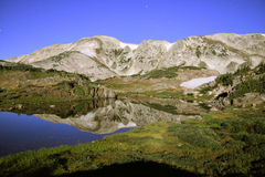 Long exposure night shot of the Medicine Bow Mountains of Wyoming, alpine lake, and stars Royalty Free Stock Images