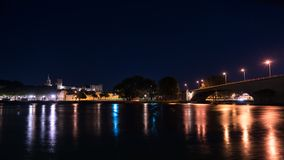 Night view of Palace of Pope in Avignon , France Rhone river in foreground with crossing bridge royalty free stock photography