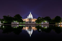 Long Exposure at Night of the United States Capitol with reflect. Ion off Water Royalty Free Stock Photo