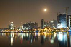 Long exposure night view of Marginal de Luanda with full moon and Mars moments before lunar eclipse stock images