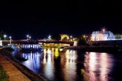 Long exposure of Nis city on a summer night and colorful beautiful river Nisava with float restaurant, bridge and fortress royalty free stock images