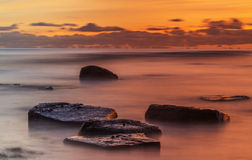 Long exposure ocean sunset Stock Photo