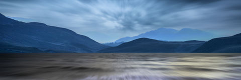 Long exposure panorama landscape of stormy sky and mountains  ov Stock Photo