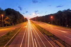 Long exposure photo on a highway at sunset Royalty Free Stock Images