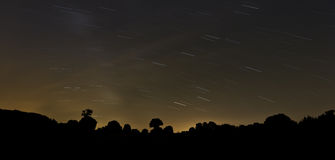 Long exposure photo of night sky. With stars trail Stock Photography