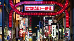 Long exposure photo of people at Kabukicho in the Shinjuku, an entertainment and red-light district, Tokyo, Japan. Tokyo, Japan - August 2018: Long exposure stock photography