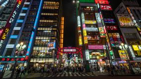 Long exposure photo of people at Kabukicho in the Shinjuku, an entertainment and red-light district, Tokyo, Japan. Tokyo, Japan - August 2018: Long exposure stock photos