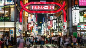 Long exposure photo of people at Kabukicho in the Shinjuku, an entertainment and red-light district, Tokyo, Japan. Tokyo, Japan - August 2018: Long exposure royalty free stock photo
