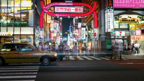 Long exposure photo of people at Kabukicho in the Shinjuku, an entertainment and red-light district, Tokyo, Japan. Tokyo, Japan - August 2018: Long exposure royalty free stock photos