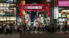 Long exposure photo of people at Kabukicho in the Shinjuku, an entertainment and red-light district, Tokyo, Japan. Tokyo, Japan - August 2018: Long exposure stock photo
