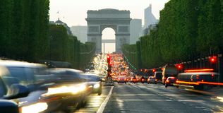 Long exposure photo of street traffic near Arc de Triomphe, Champs Elysees boulevard. Paris, France Stock Photos
