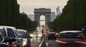 Long exposure photo of street traffic near Arc de Triomphe. Champs Elysees boulevard. Paris, France Royalty Free Stock Images