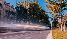 long exposure photo taken in Avenida da República, Lisbon  with  moving vehicles  and some greenery date 2 July 2019 royalty free stock images