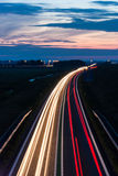 Long exposure photo of traffic on the move at dusk Stock Photos