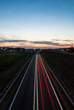 Long exposure photo of traffic on the move at dusk Royalty Free Stock Photography