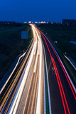 Long exposure photo of traffic on the move at dusk Stock Photo