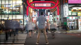 Long exposure photo of an unidentified man standing at Kabukicho district in the Shinjuku, Tokyo, Japan. Tokyo, Japan - August 2018: Long exposure photo of an royalty free stock photography