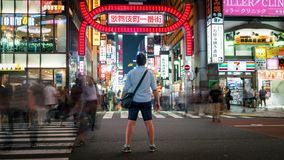 Long exposure photo of an unidentified man standing at Kabukicho district in the Shinjuku, Tokyo, Japan. Tokyo, Japan - August 2018: Long exposure photo of an stock photography
