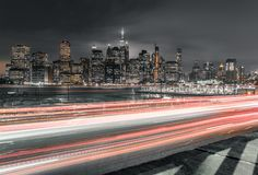 Long exposure of traffic with downtown Manhattan in view stock photo
