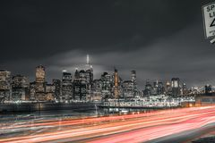 Long exposure of traffic with downtown Manhattan in view stock photography