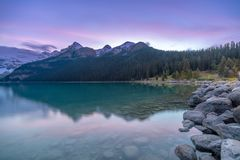 Long exposure photography of purple blue sky during dusk at Lake Louise stock photos