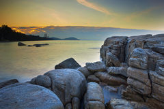 Long exposure photography of rock beach mae rumpung rayong easte. Long exposure photography    of rock beach mae rumpung rayong easte Royalty Free Stock Image