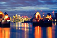 Thames Barrier and Canary Wharf in London. Long exposure photography, Thames Barrier and Canary Wharf in London Royalty Free Stock Images