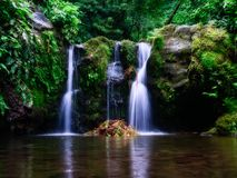 Long exposure picture of a beautiful waterfall with little lake in the rain forest. long exposure royalty free stock photo