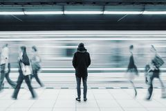 Free Long Exposure Picture With Lonely Man At Subway Station With Blurry Moving Train And Walking People Stock Image - 141666931