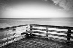 Long exposure a pier and the Chesapeake Bay in Chesapeake Beach, Royalty Free Stock Photos