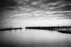 Long exposure of a pier in the Chesapeake Bay, in North Beach, M Stock Image