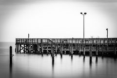 Long exposure of a pier in the Chesapeake Bay, in North Beach, M Royalty Free Stock Image