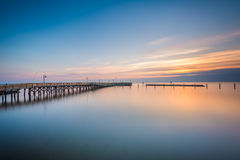 Long exposure of the pier and Chesapeake Bay at sunrise, in Nort Stock Images