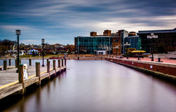 Long exposure of a pier and the Maryland Science Center at the I Stock Image