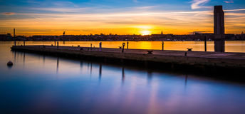 Long exposure of a pier at sunset, in Fells Point, Baltimore, Ma Stock Photography