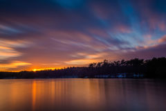 Long exposure of Prettyboy Reservoir at sunset, in Baltimore Cou Royalty Free Stock Images