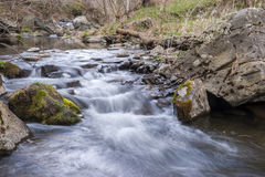 Long exposure of rapids of a small stream during winter Royalty Free Stock Photos