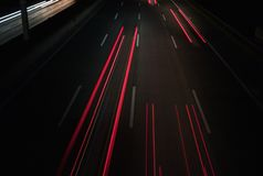 Traffic at night: Light Trails on a Motorway - abstract background stock image