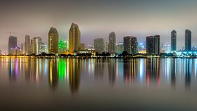 Long exposure reflection of downtown San Diego. Buildings of downtown San Diego reflect off the water of the bay stock image