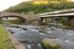 Lynmouth in Devon. Long exposure of the river flowing under the bridge in Lynmouth in Devon stock photography