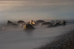 Long Exposure of River Rocks and Shoreline Royalty Free Stock Photography