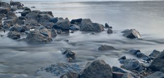 Long exposure river stones royalty free stock photography