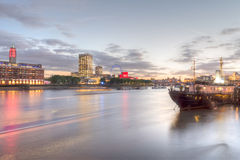 Long exposure of the river Thames in the evening, London, UK Royalty Free Stock Photos