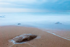 Long Exposure: Rock on the beach. Long exposure at a beach in the north of Portugal. Copy space royalty free stock photos