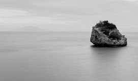 Long exposure of rock in black and white. Long exposure of rock in black and white on the coast of south Corfu Greece Royalty Free Stock Image