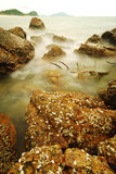 Long exposure of rocks on sea Royalty Free Stock Photography
