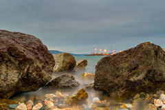 Long exposure of a rocky beach at Oropos in Greece. Stock Images