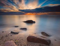 Long exposure rocky beach sunrise. Baltic coast in Gdynia Orłowo Royalty Free Stock Photo
